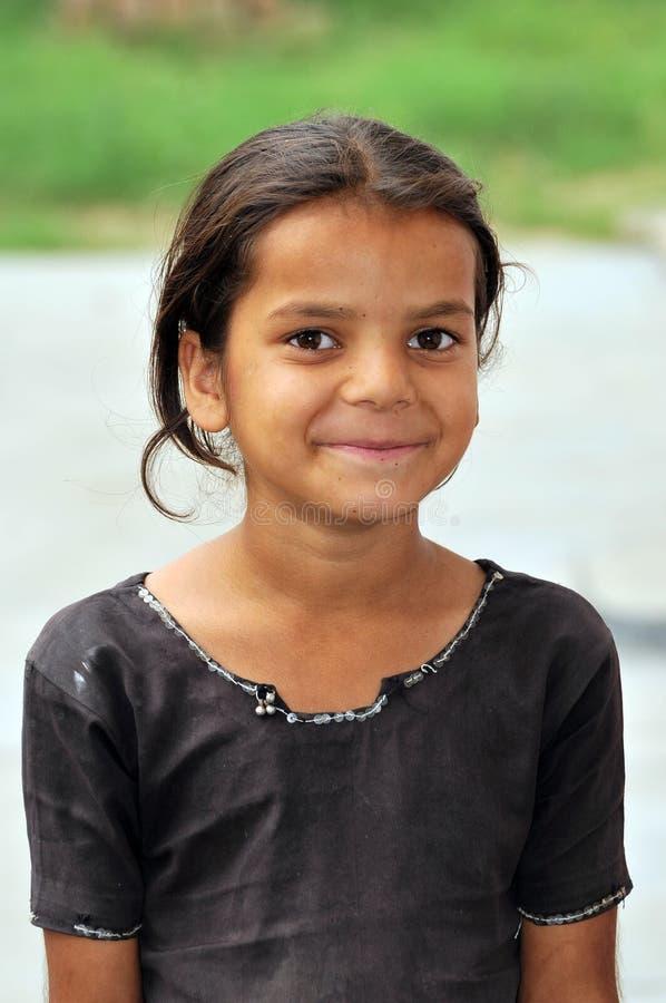 女孩微笑的一点 免版税库存照片