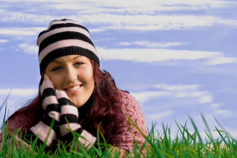 女孩愉快微笑 免版税库存图片