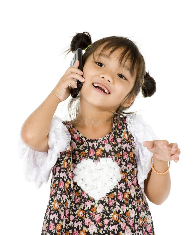 女孩愉快的小的电话 免版税库存图片