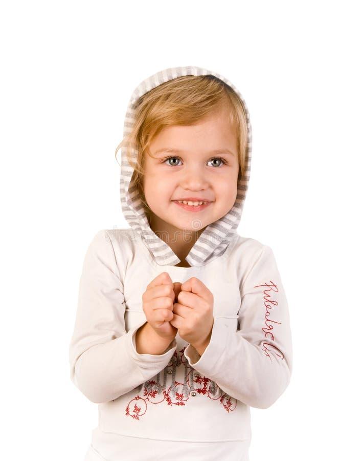 女孩愉快的小的面带笑容 免版税图库摄影