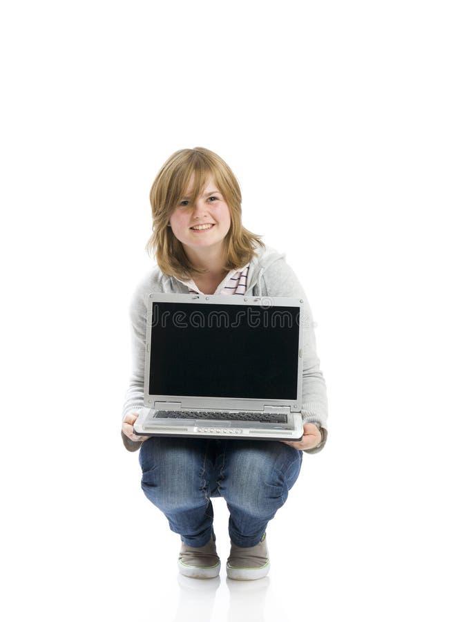 女孩愉快的查出的膝上型计算机年轻人 免版税库存照片