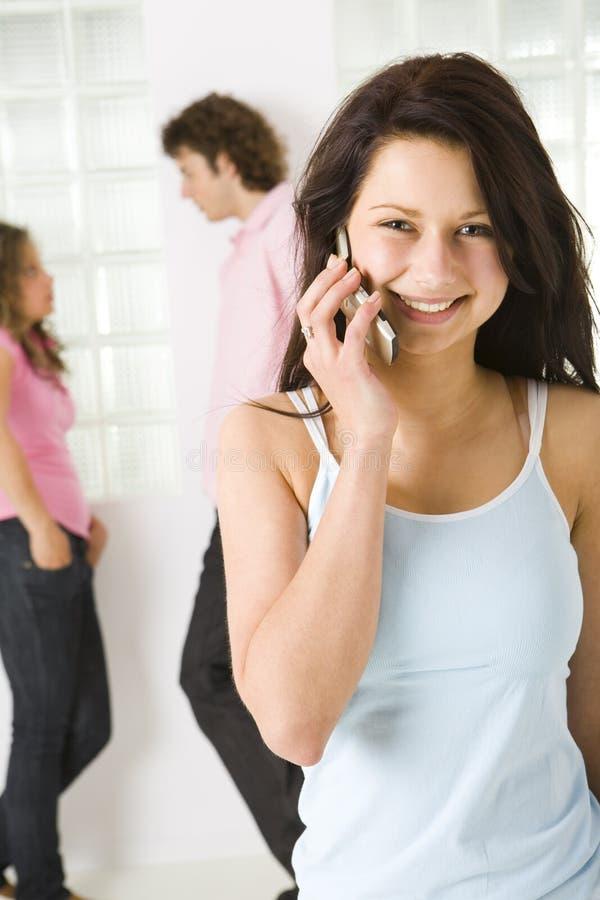 女孩愉快的移动电话 免版税库存照片
