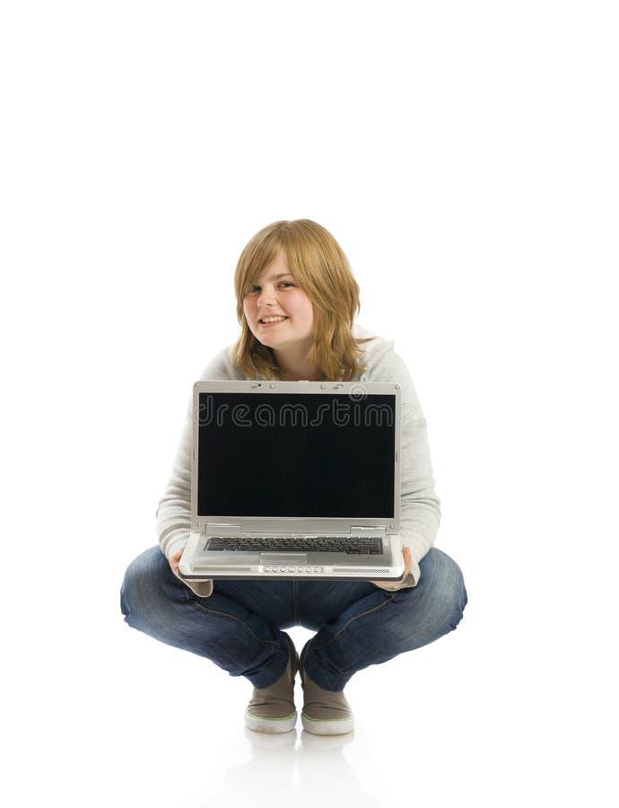 女孩愉快的膝上型计算机年轻人 库存图片