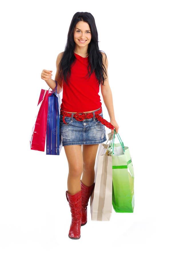 女孩愉快的购物 免版税库存图片