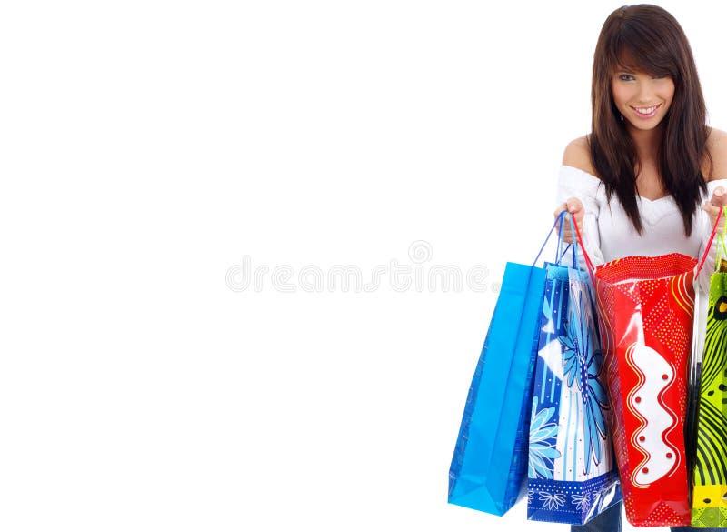 女孩愉快的购物 免版税库存照片