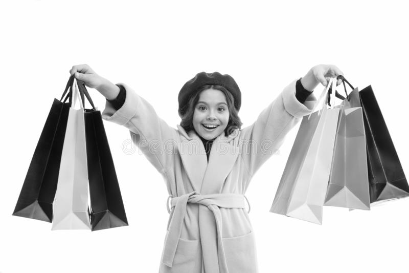 女孩愉快的面孔举行束购物带来 Shopaholic?? 孩子满足了购物的被隔绝的白色背景 图库摄影