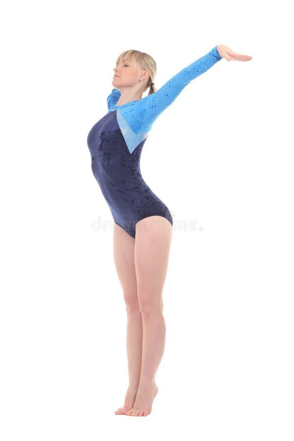 女孩执行体操锻炼 免版税图库摄影
