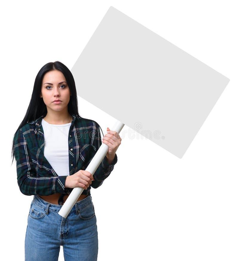 女孩拿着一个空白的广告牌 图库摄影