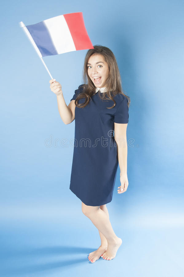 女孩挥动法国旗子 免版税图库摄影