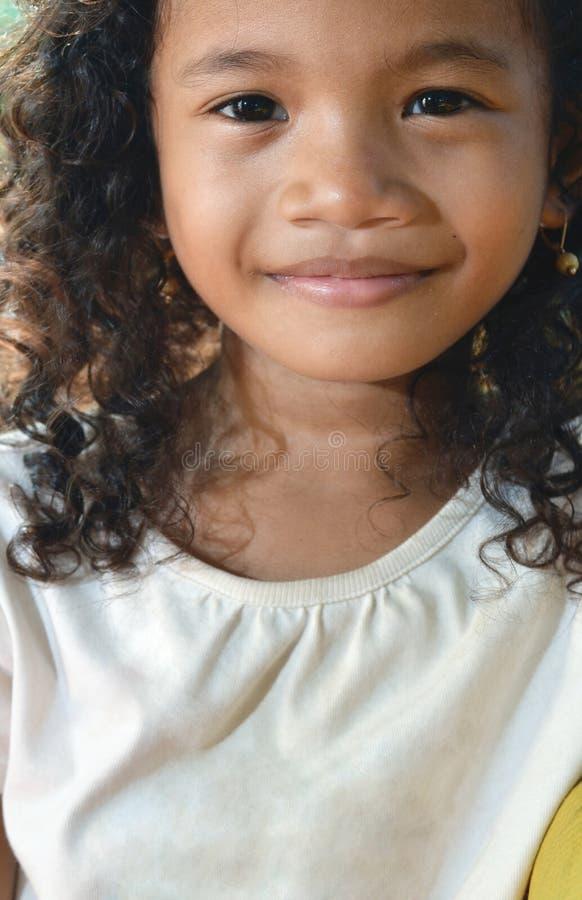 女孩无辜的微笑 库存照片