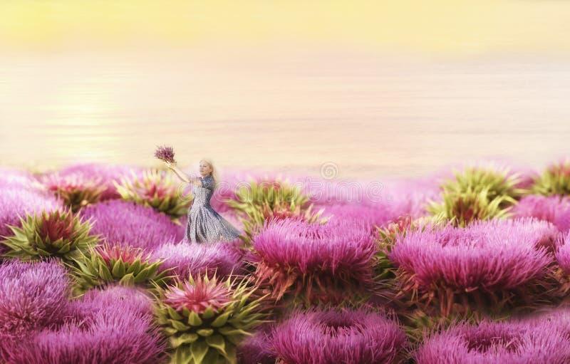 女孩是在大淡紫色花中 幻想图片 库存图片