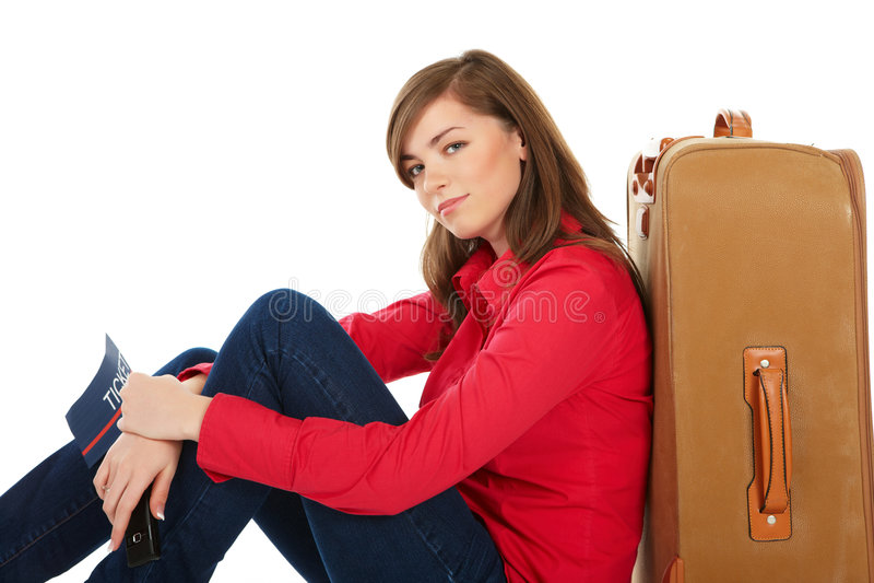 女孩最近的坐的手提箱 库存照片
