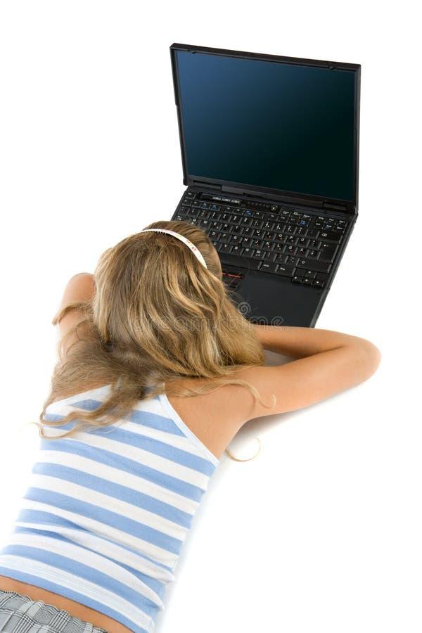 女孩查出膝上型计算机青少年的白色 免版税库存图片