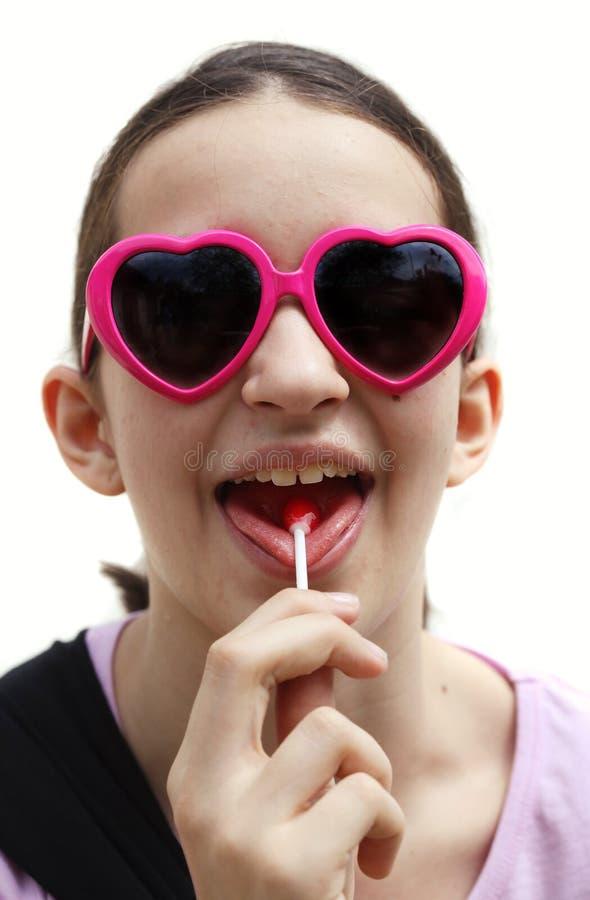 女孩棒棒糖年轻人 库存图片