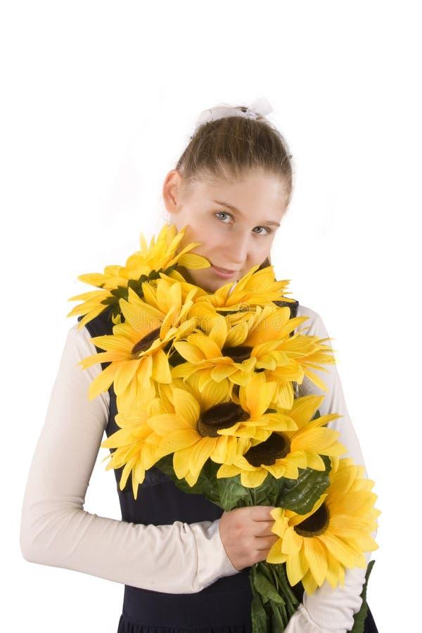 女孩植入向日葵 库存照片