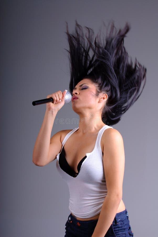 女孩歌唱家 库存照片