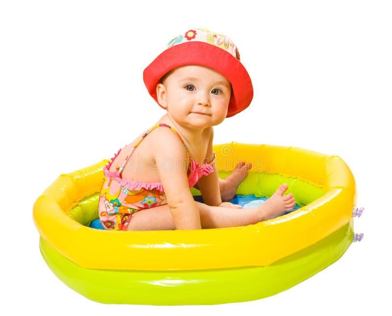 女孩池游泳 免版税库存照片
