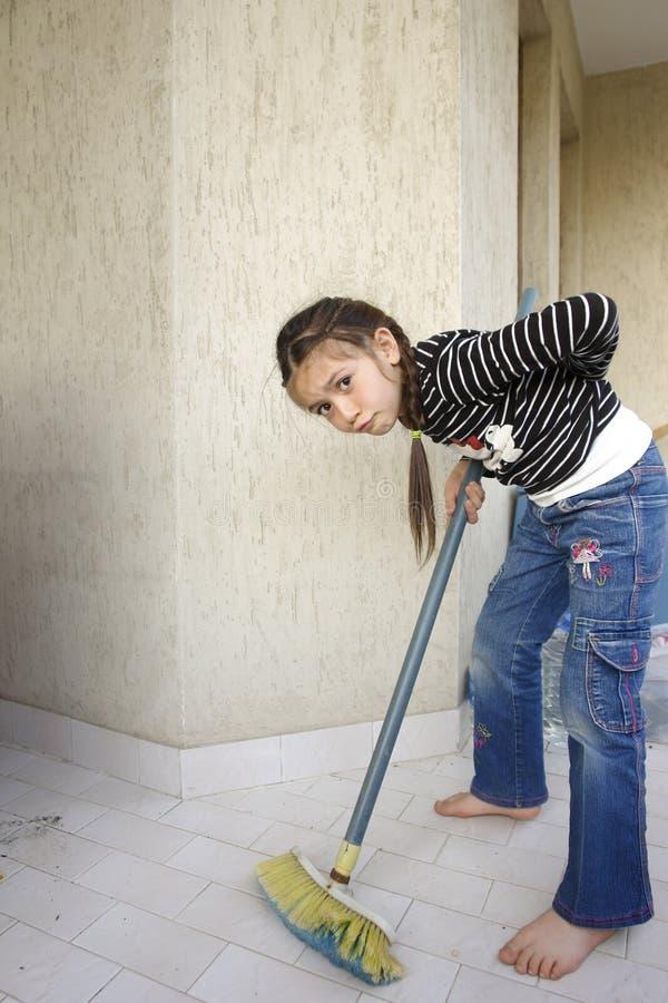 女孩清洗在家与疲乏的神色 库存照片