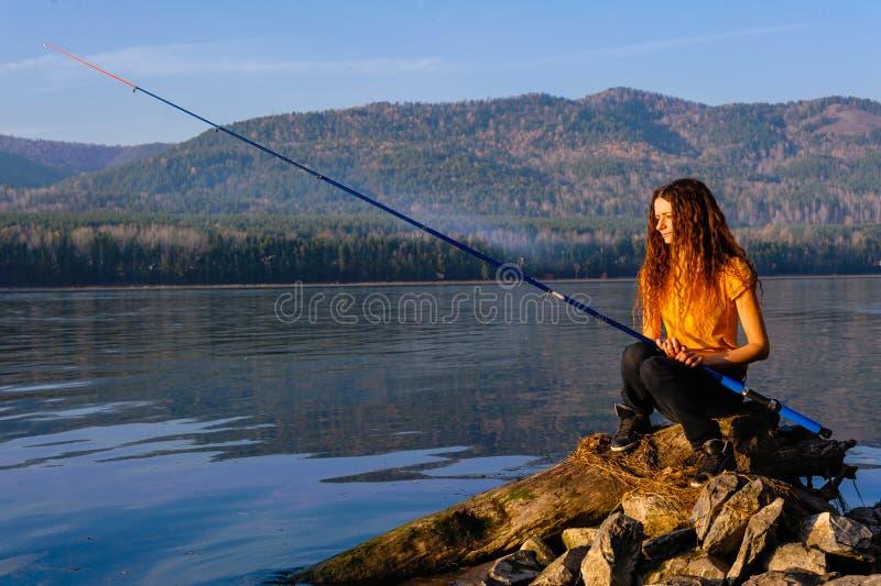 女孩渔夫 库存照片