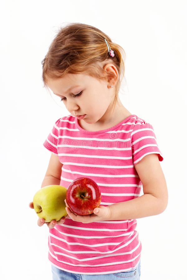 女孩烦恶苹果 库存图片