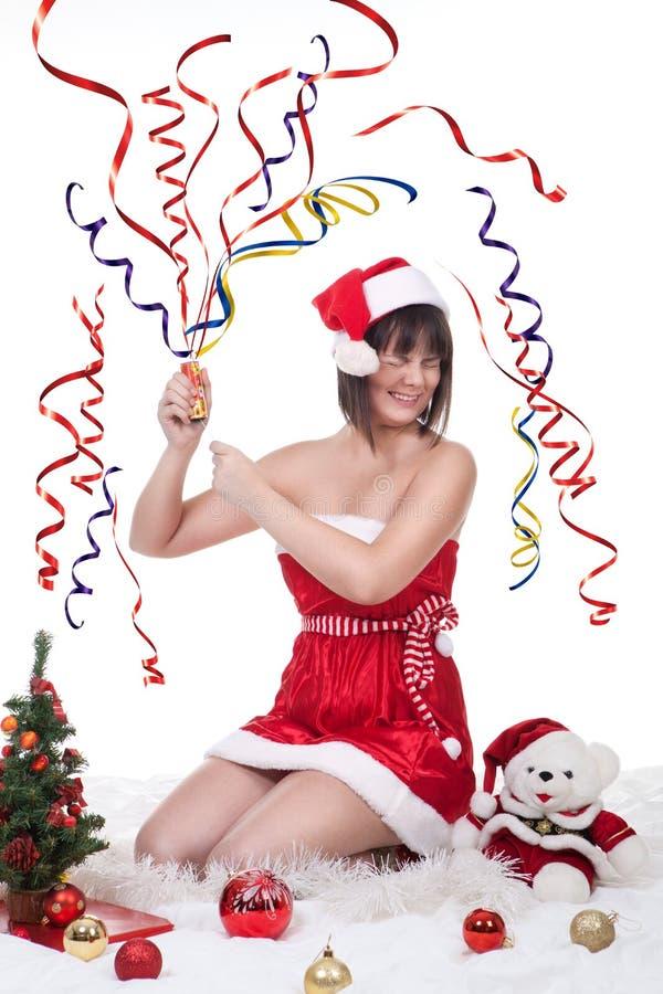女孩爆炸的圣诞节薄脆饼干 免版税库存照片