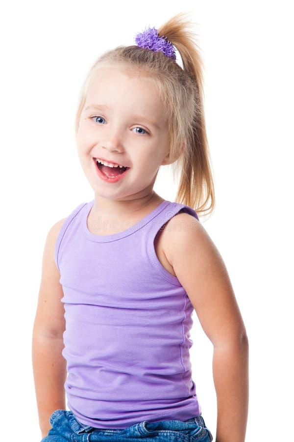 女孩牛仔裤少许紫色衬衣微笑的t 免版税库存图片