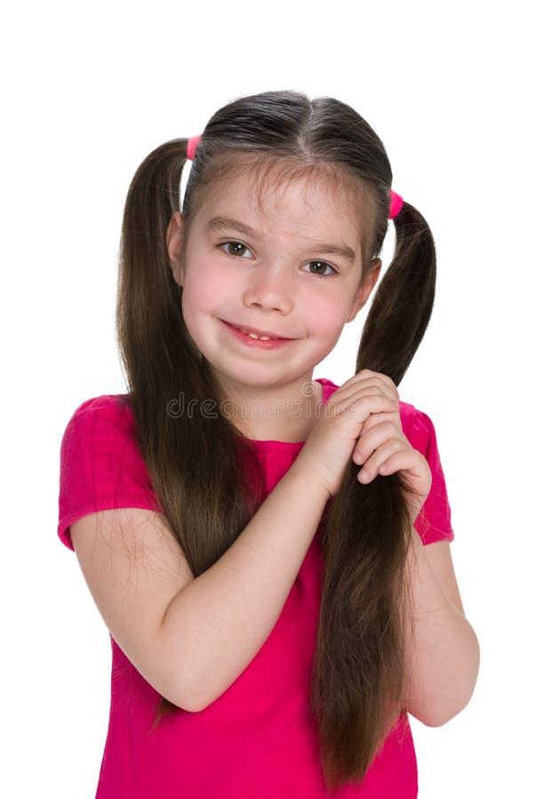 女孩猪尾微笑 免版税图库摄影