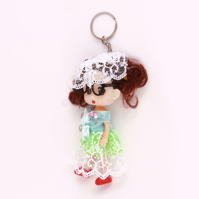 女孩玩偶奖牌钥匙 库存照片