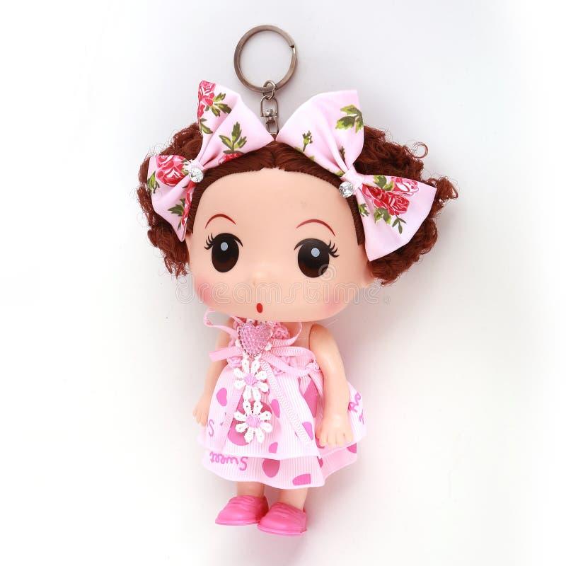 女孩玩偶奖牌钥匙 免版税库存照片