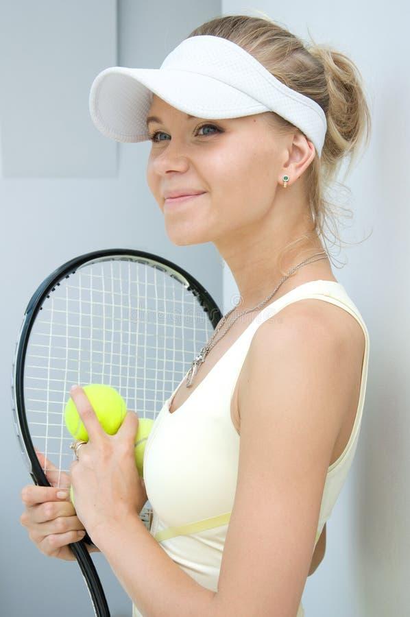 女孩球拍网球 免版税库存图片
