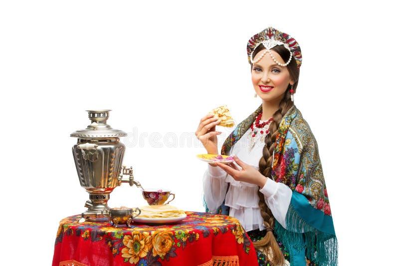 女孩用薄煎饼 免版税图库摄影