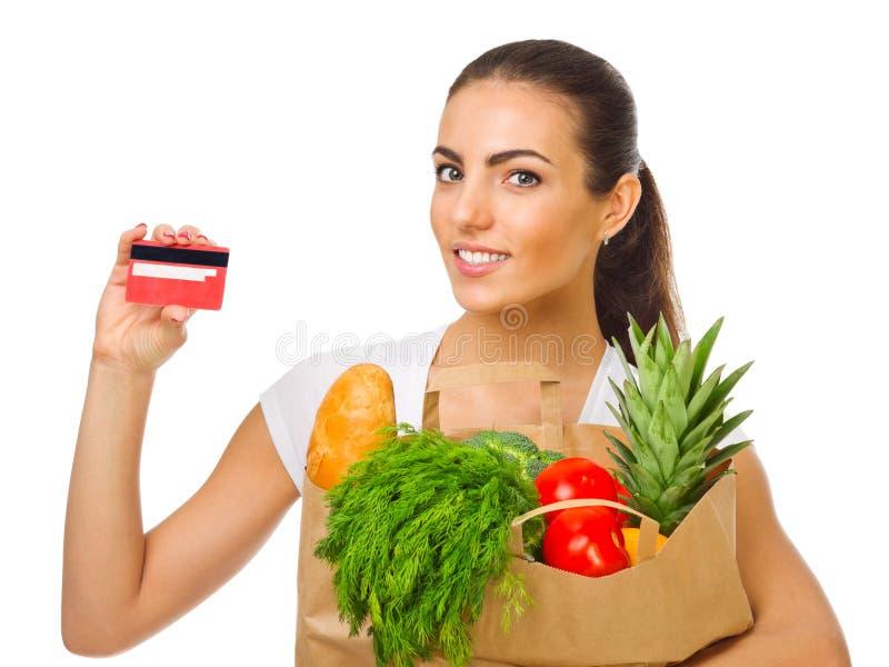 女孩用水果、蔬菜和塑料卡片 库存图片