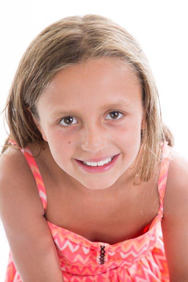 女孩画象夏天桃红色礼服的 图库摄影