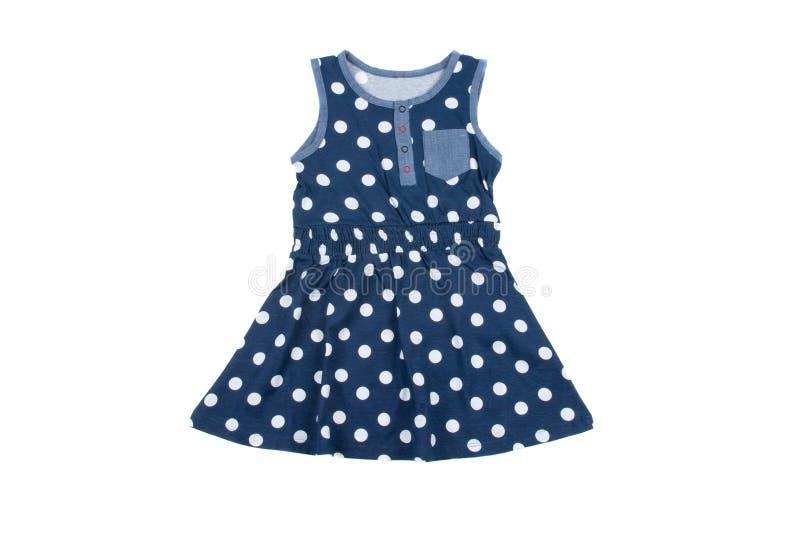 女孩的小蓝色圆点礼服,隔绝在白色 图库摄影