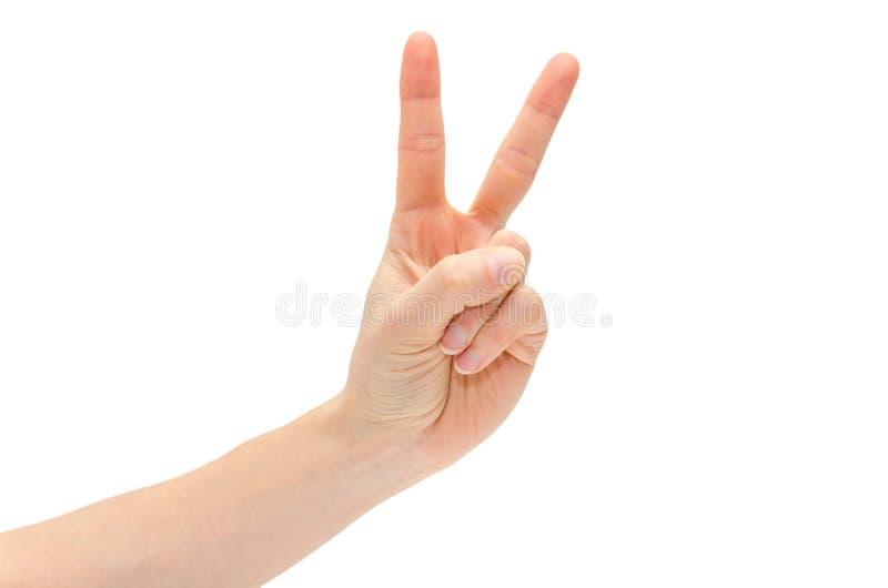 女孩的手显示胜利 免版税库存图片