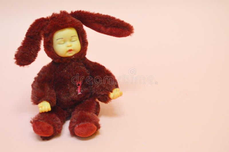 女孩的玩具桃红色背景的 免版税图库摄影