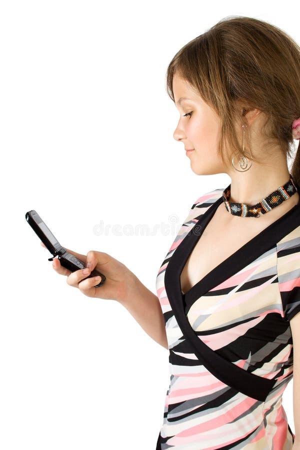 女孩相当读了新的sms 免版税库存图片