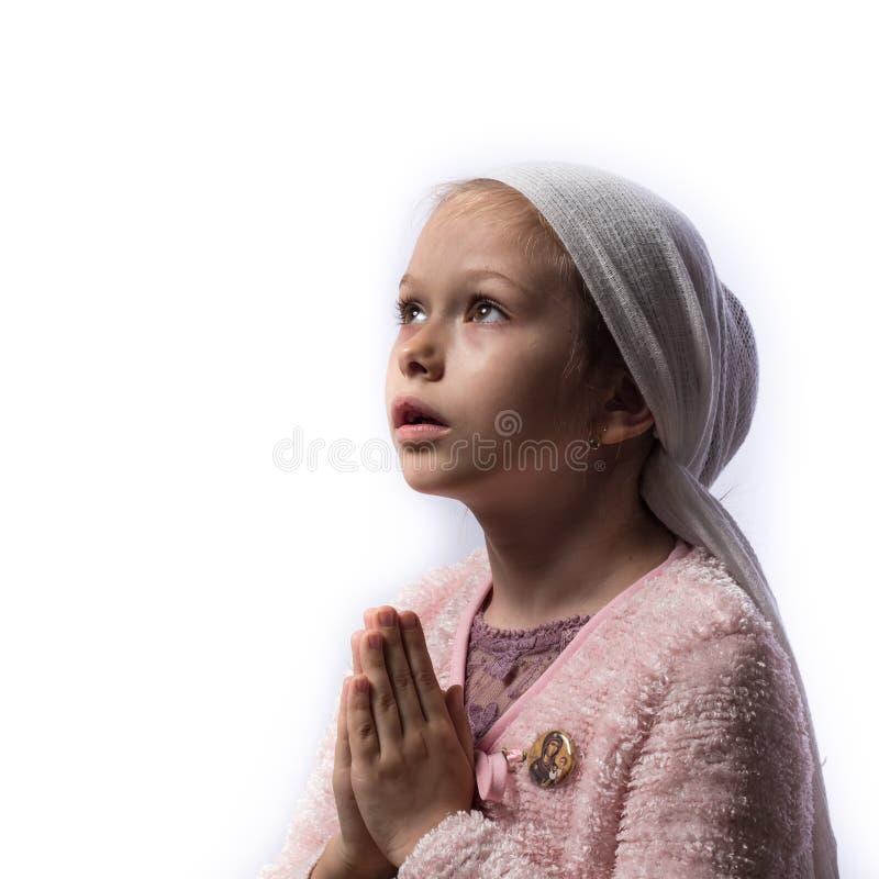 女孩祈祷 免版税库存图片