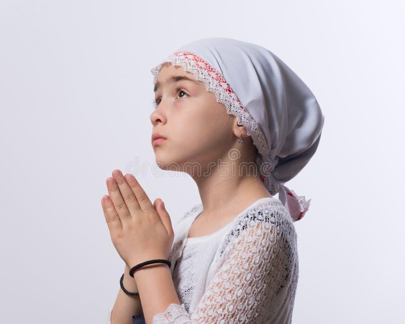 女孩祈祷 库存图片