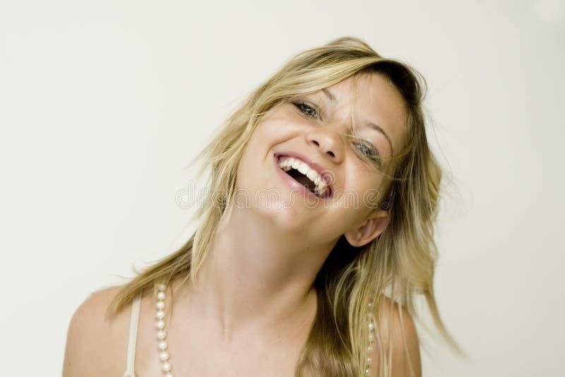 女孩笑少年 免版税库存照片