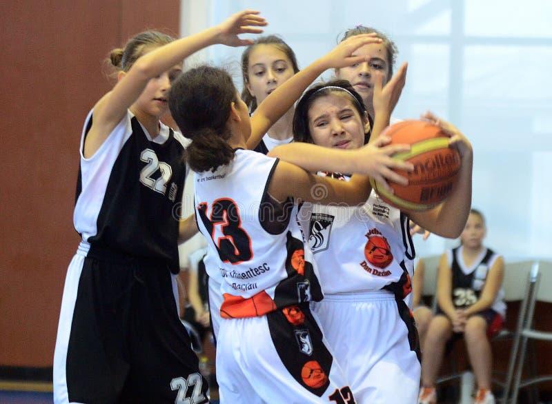 女孩篮球行动 免版税库存图片