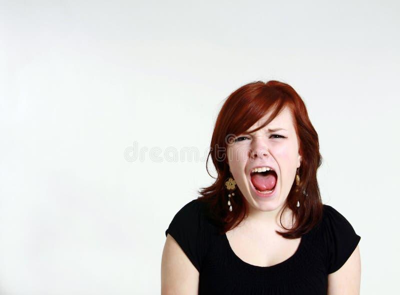 女孩红头发人青少年叫喊 库存图片