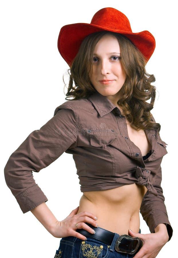 女孩红色帽子的牛仔裤 库存照片