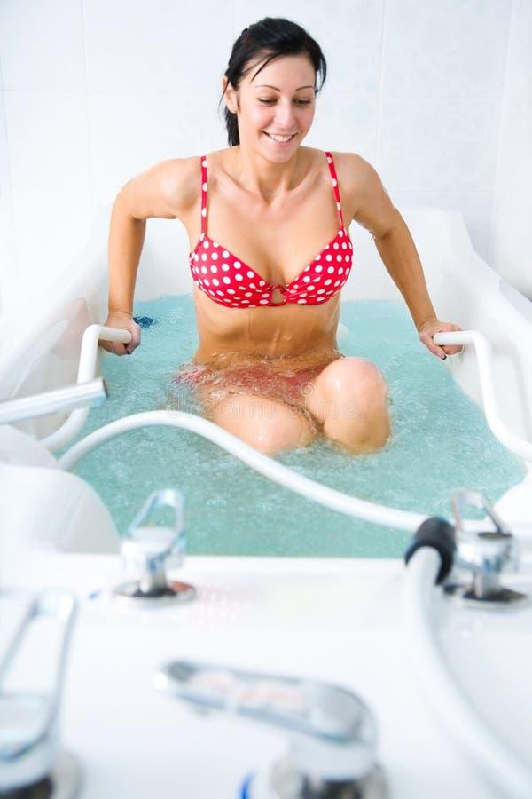 女孩红色泳装 免版税库存图片