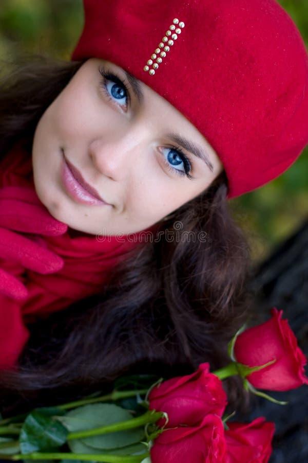 女孩红色玫瑰 库存照片