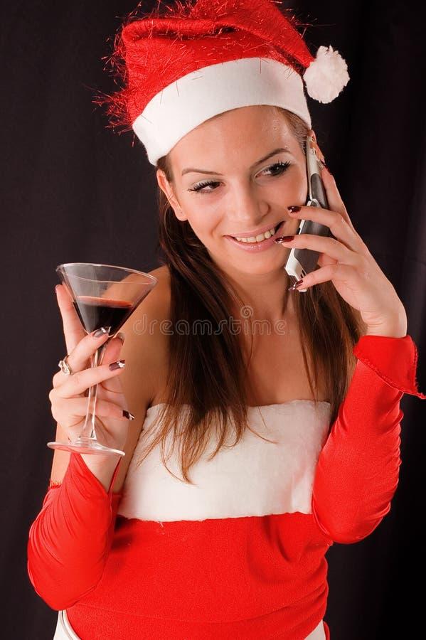女孩纵向圣诞老人 免版税库存照片
