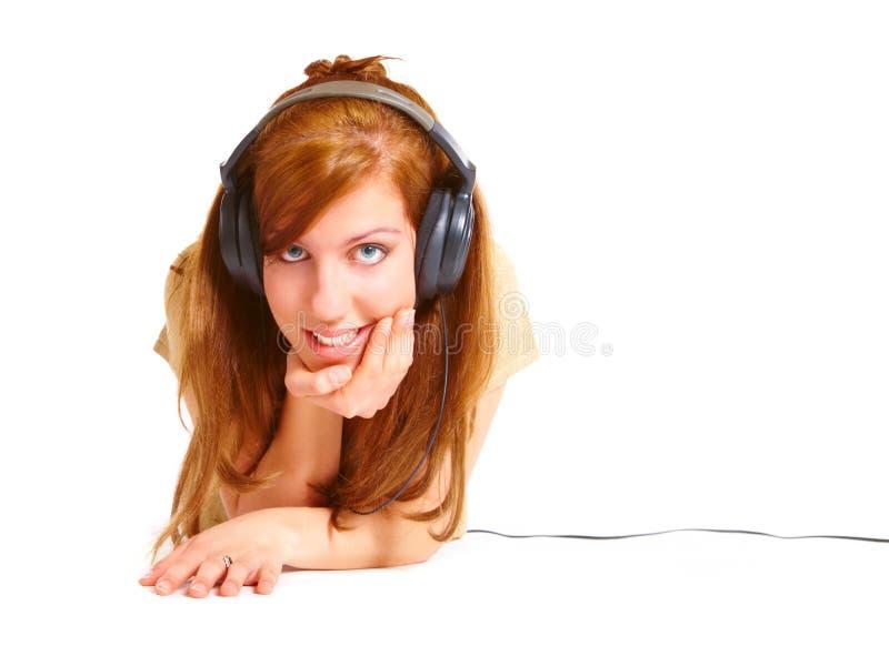 女孩耳机 库存照片