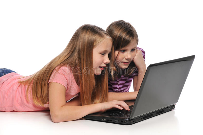 女孩膝上型计算机二 图库摄影