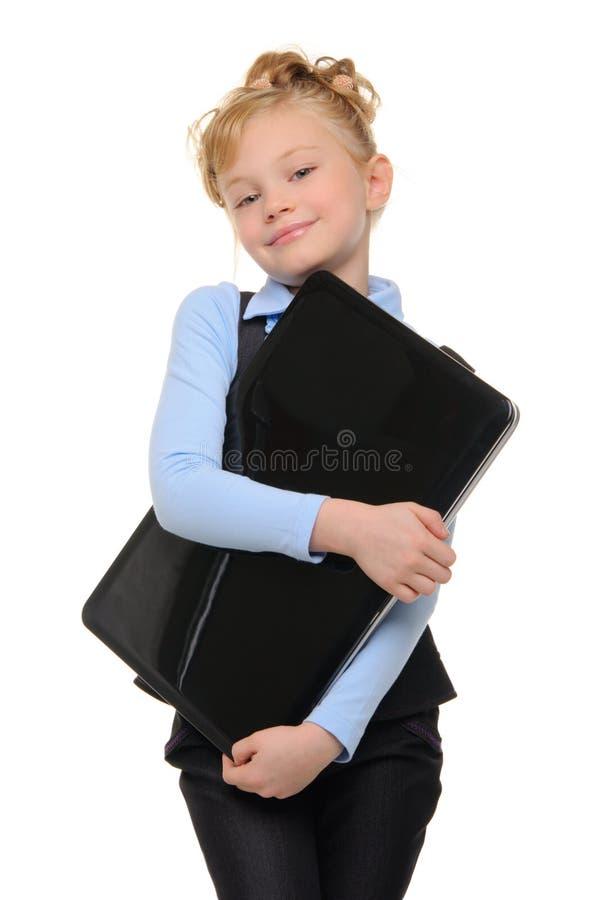 女孩膝上型计算机微笑 免版税库存图片