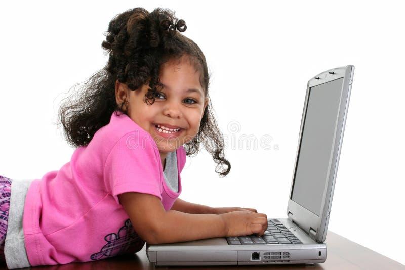 女孩膝上型计算机粉红色小孩 库存照片